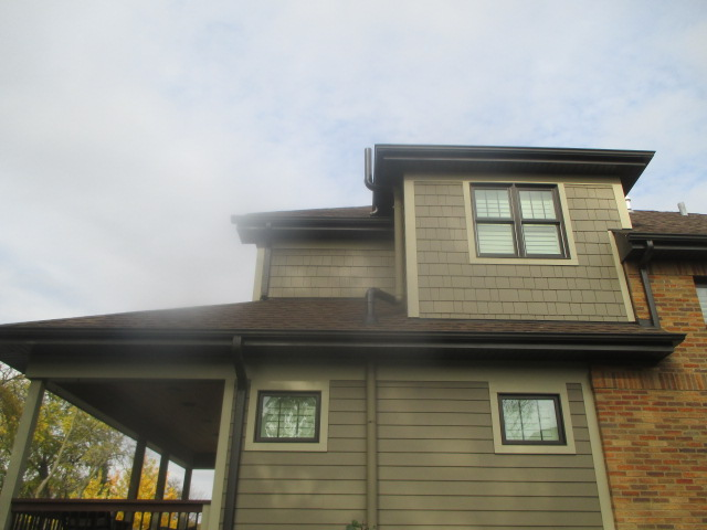 Radon System Exterior with Exhaust Pipe Through Soffit