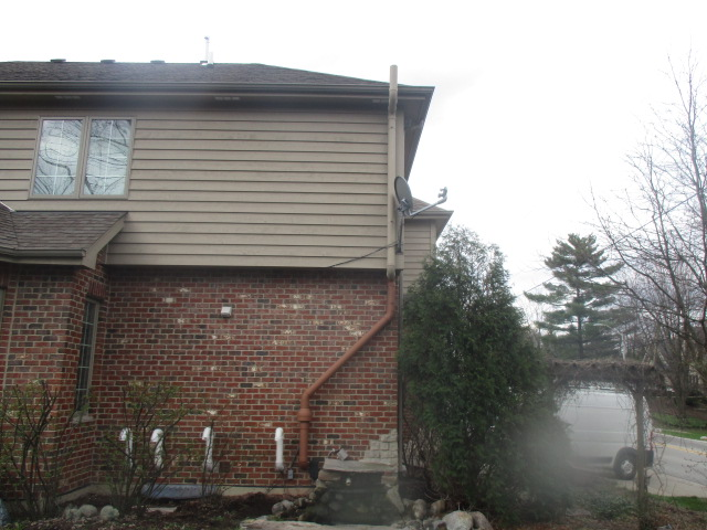 Radon System Exterior Painted Exhaust Pipe to Match House
