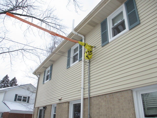 Radon-mitigation-system-exterior-protect-electrical-lines