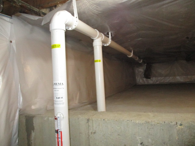 Radon-mitigation-system-suction-point-basement-and-crawl-space