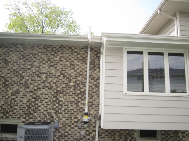 Photos Of Exterior Radon Mitigation System Installations
